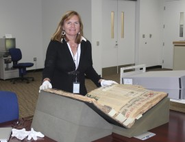 Heather  Lang researching Ruth Law's Scrapbook